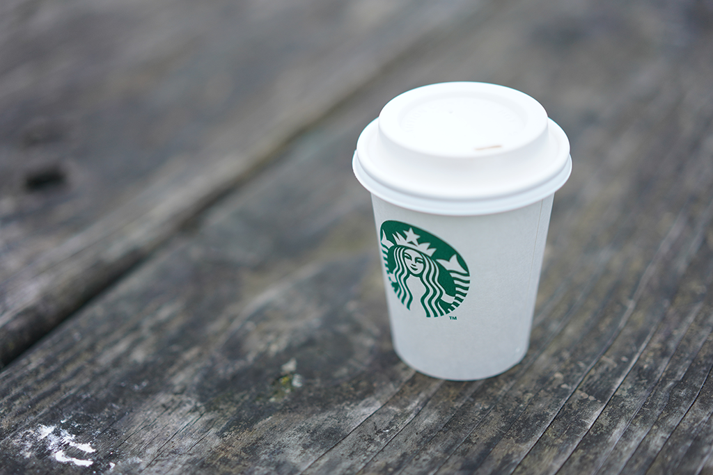 Starbucks Coffee Cup On Wooden Surface